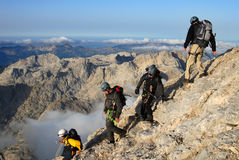 Group of people ascending the  mountain Stock Images