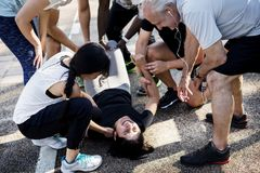 Group of people assisting an injured person Stock Photo