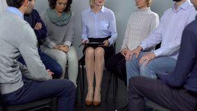 Group of people attending therapy session and talking, psychological support stock photo
