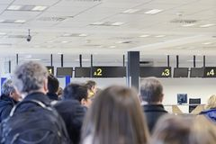 Group of people awaiting registration at the airport building. Stock Photos