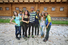 Group of people on a background of wooden building Stock Photo