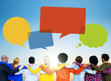 Group of People Backwards with Speech Bubbles Royalty Free Stock Photo