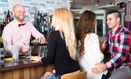 Group of people in a bar Stock Images