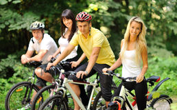 Group of people on a bicycles in a countryside - portrait Stock Image