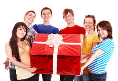 Group of people with big red gift box. Royalty Free Stock Photo