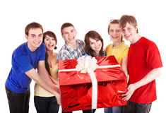 Group of people with big red gift box. Stock Photos