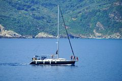 Sailing near Skopelos, Greece. Group of people on a boat sailing by Skopelos shores stock photo