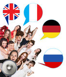 Group of people and bubbles with countries' flags Stock Photography