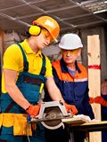 Group people  builder with circular saw . Stock Image