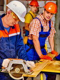 Group people  builder with circular saw Stock Photo