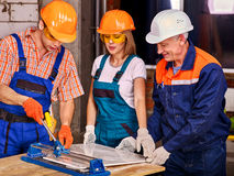 Group people builder cutting ceramic tile Royalty Free Stock Images