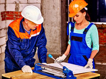 Group people builder cutting ceramic tile Stock Images