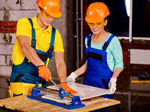 Group people builder cutting ceramic tile Stock Image