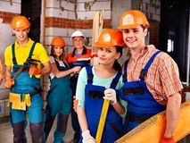 Group people in builder uniform. Royalty Free Stock Photo