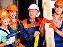 Group people in builder uniform. Royalty Free Stock Images