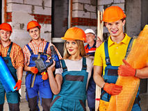 Group people in builder uniform. Stock Images
