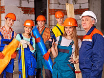 Group people in builder uniform. Stock Photography