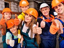 Group people in builder uniform. Royalty Free Stock Photography