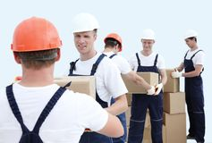 Group of people builders with boxes. Happy male movers in uniform carrying boxes Stock Image