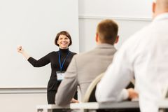 Group of people at business conference or lecture Stock Images