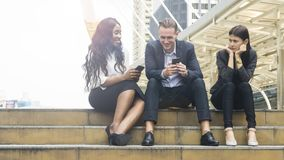 Group people business use smart phone with woman feel stressed a. The group people business use smart phone with women feel stressed and disappointed and sit on Royalty Free Stock Photography