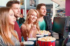 Group of people buying popcorn and coke Royalty Free Stock Photo