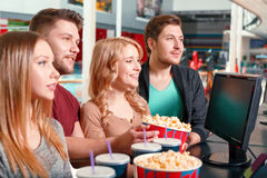 Group of people buying popcorn and coke Stock Images