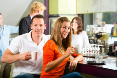 Group of people in Cafe drinking coffee Stock Photos