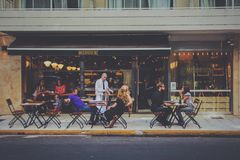 Group of People in Cafe Near Road during Daytime Stock Photography