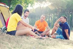 Group of People Camping and telling a story Stock Images