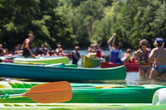 Group of People Canoeing and Kayaking on River, Trees in Background Stock Photo