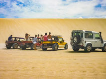 Group of People at Cars in Jericoacoara Dunes stock image
