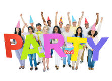 Group of people celebrating with balloons and gifts Royalty Free Stock Photos