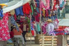 A group of people chating while waiting for costumers. Villa de Leyva, Boyaca, Colombia - June 3, 2017: A group of people chating while waiting for costumers in royalty free stock image