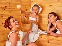Group people with child in sauna Stock Photography