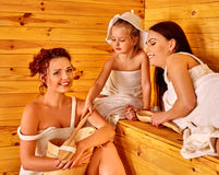Group people with child in sauna Stock Photo