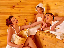 Group people with child in sauna. Stock Images