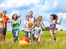 Group people with children running. Royalty Free Stock Photo