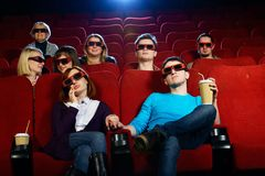 Group of people in cinema. Group of people in 3D glasses watching movie in cinema royalty free stock images