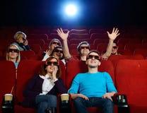 Group of people in cinema. Group of people in 3D glasses watching movie in cinema royalty free stock image
