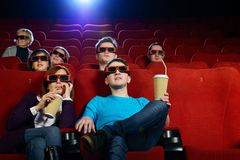 Group of people in cinema. Group of people in 3D glasses watching movie in cinema royalty free stock photography