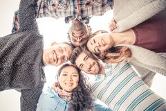 Group of people in circle formation Stock Image