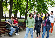 Group of people in city park listen music. Stock Images