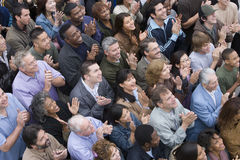 Group Of People Clapping. High angle view of multiethnic people clapping together stock photography