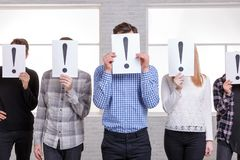 A group of people close their faces with an exclamation mark close-up Stock Photography