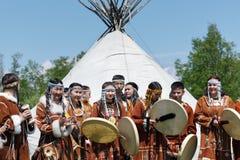 Group of people in clothing aborigine of Kamchatka stand on background at yaranga Royalty Free Stock Photos