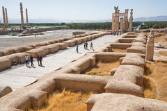 Group of people come in area of destroyed city Persepolis Stock Image