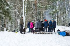 People in forest on wintertime stock image