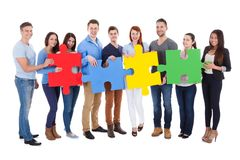 Group of people connecting puzzle pieces. Over white background royalty free stock photo