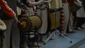 A group of people in costumes playing the African drums stock footage